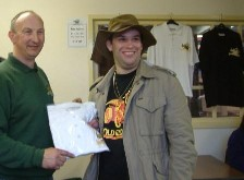 Geoff congratulates our 3000th visitor Alex Smith and presents him with souvenir T-shirt